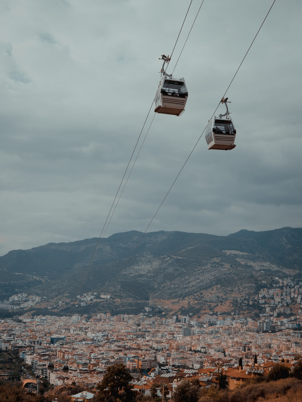 low angle photography of two white cable carts