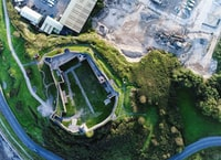 aerial view of green grass field near establishments