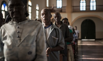 people attending mass in church mozambique zoom background