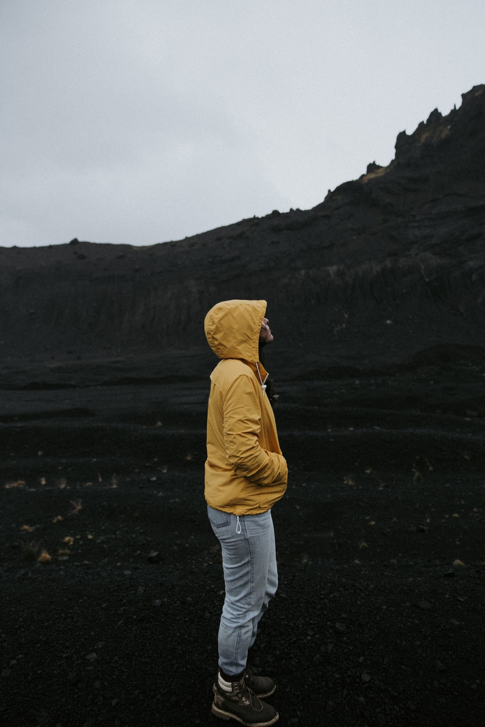 person standing beside mountain