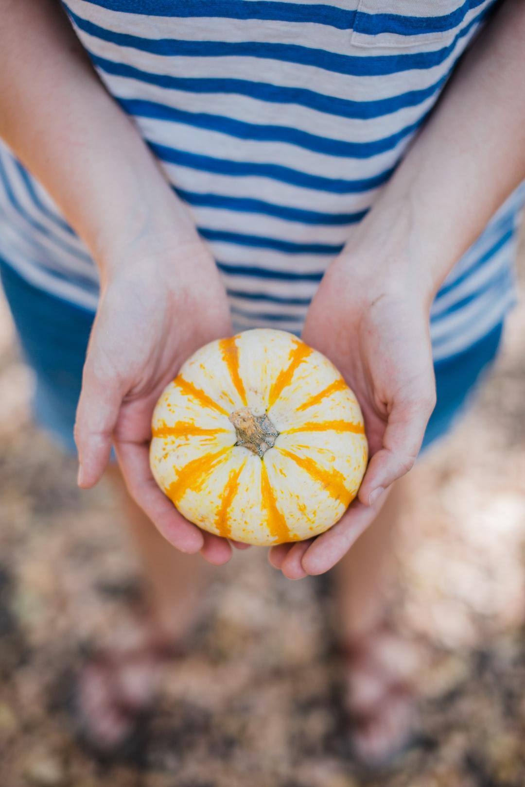 Holding Pumpkins