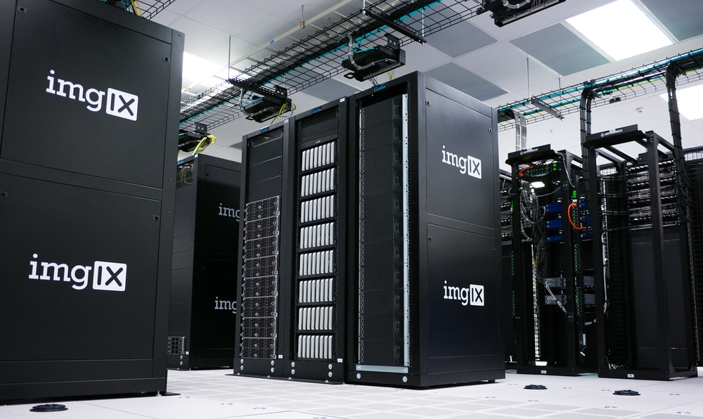 image of inside white and gray room full of servers representing server-side headerbidding