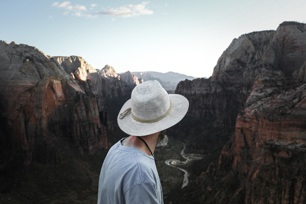 person looking on rock mountain during daytime