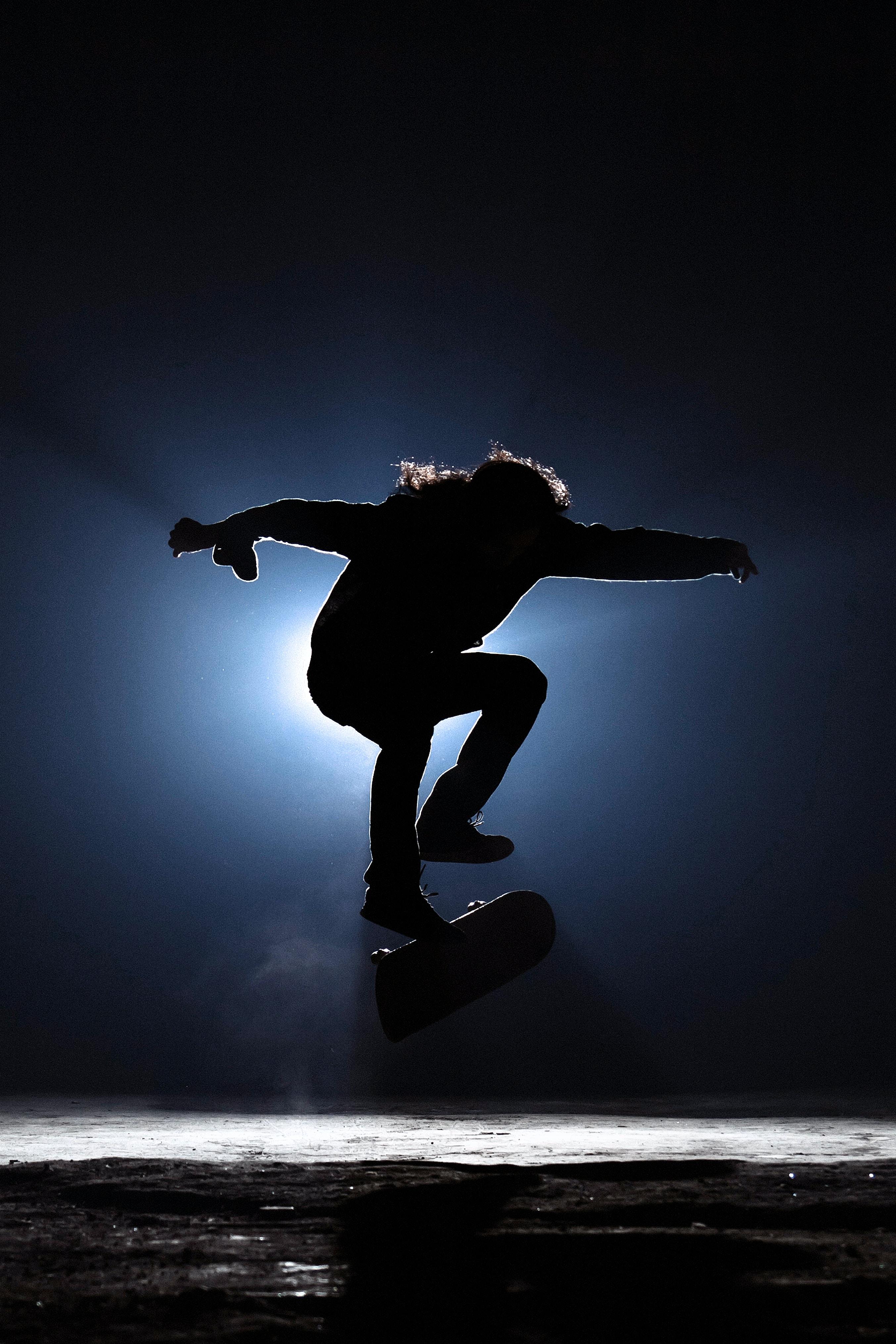 photo of man playing skateboard