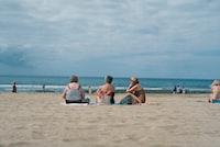 three women sitting on beach