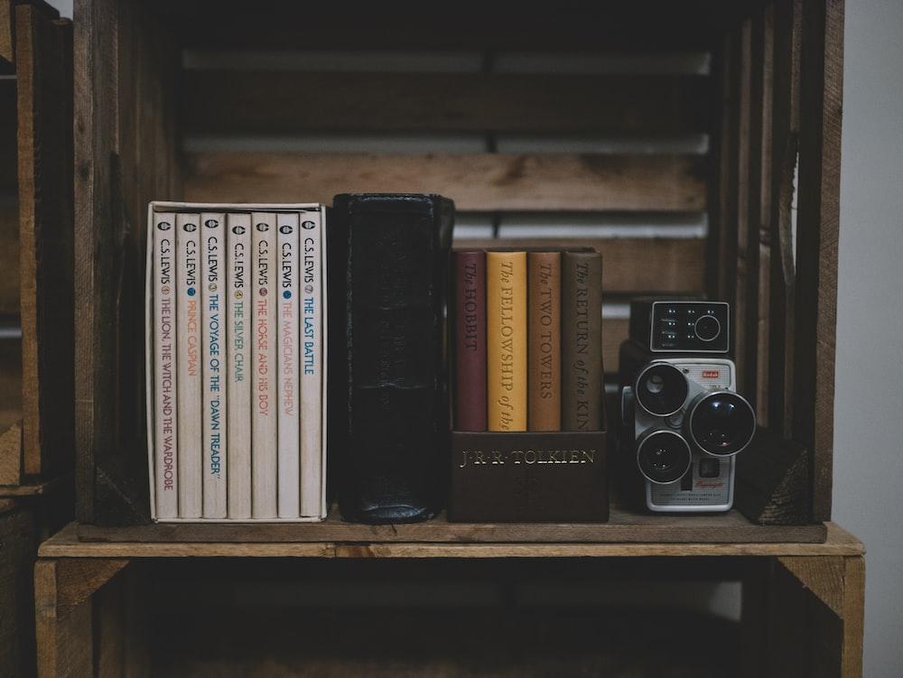 camera on brown wooden shelf