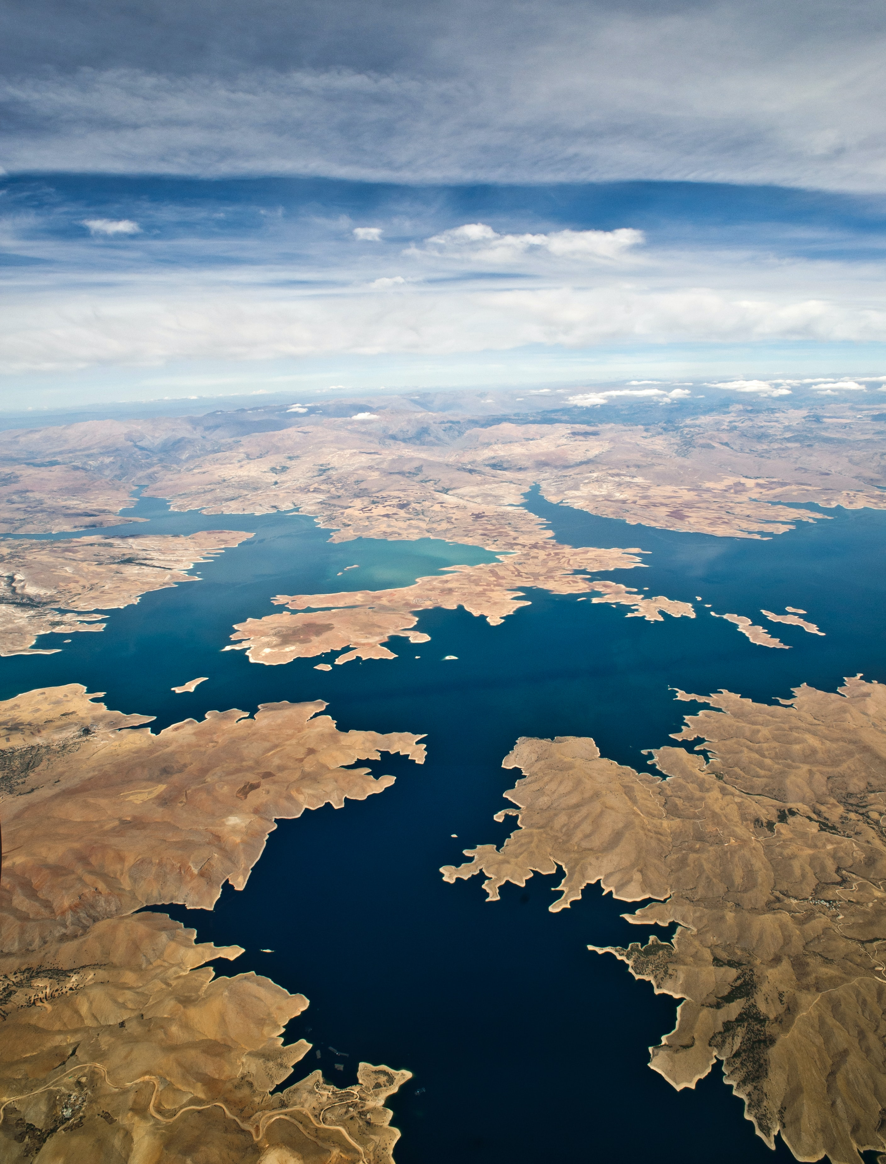 aerial shot of body of water surrounded by land