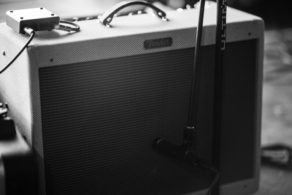 grayscale photography of guitar amplifier
