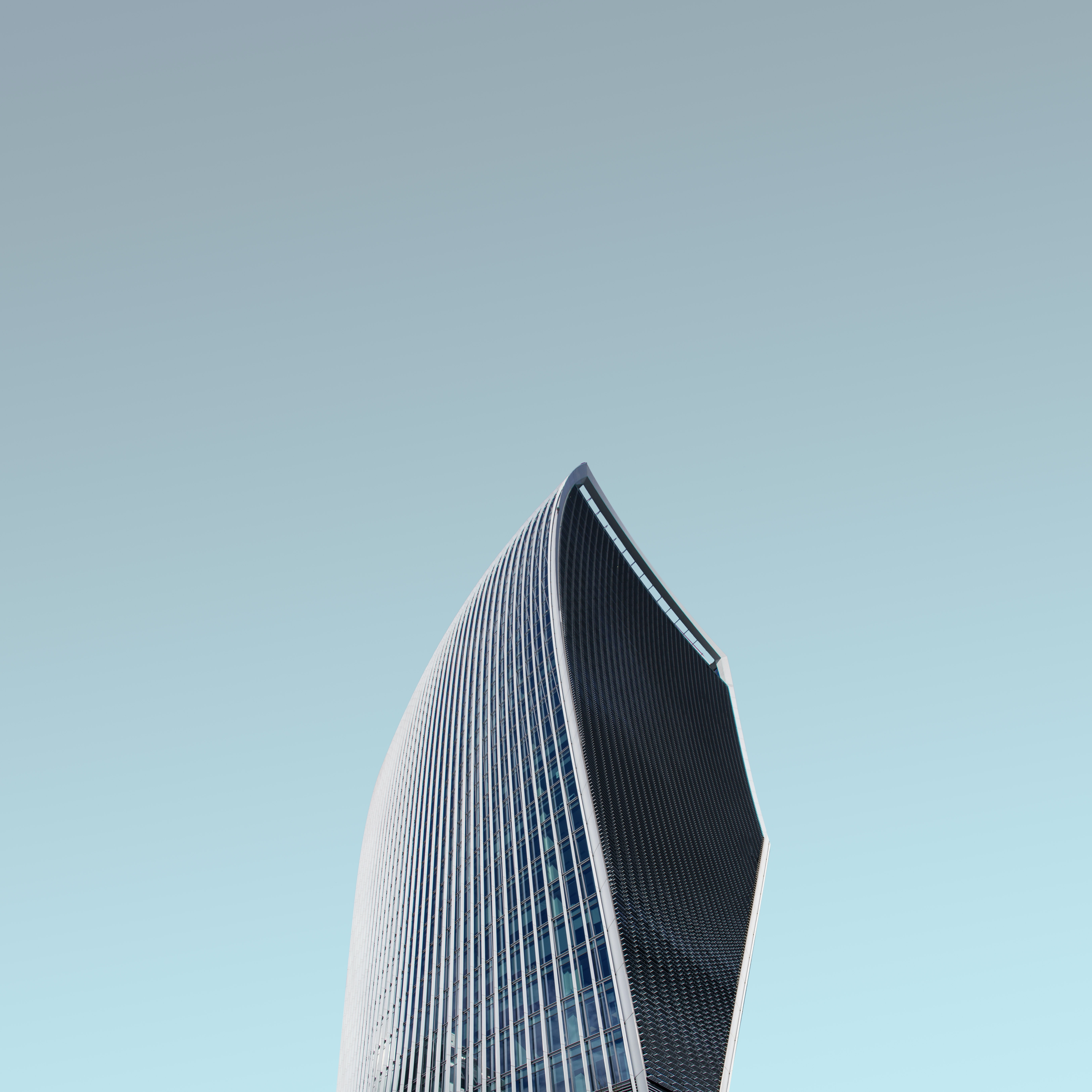 worm's eye view photography of glass tower