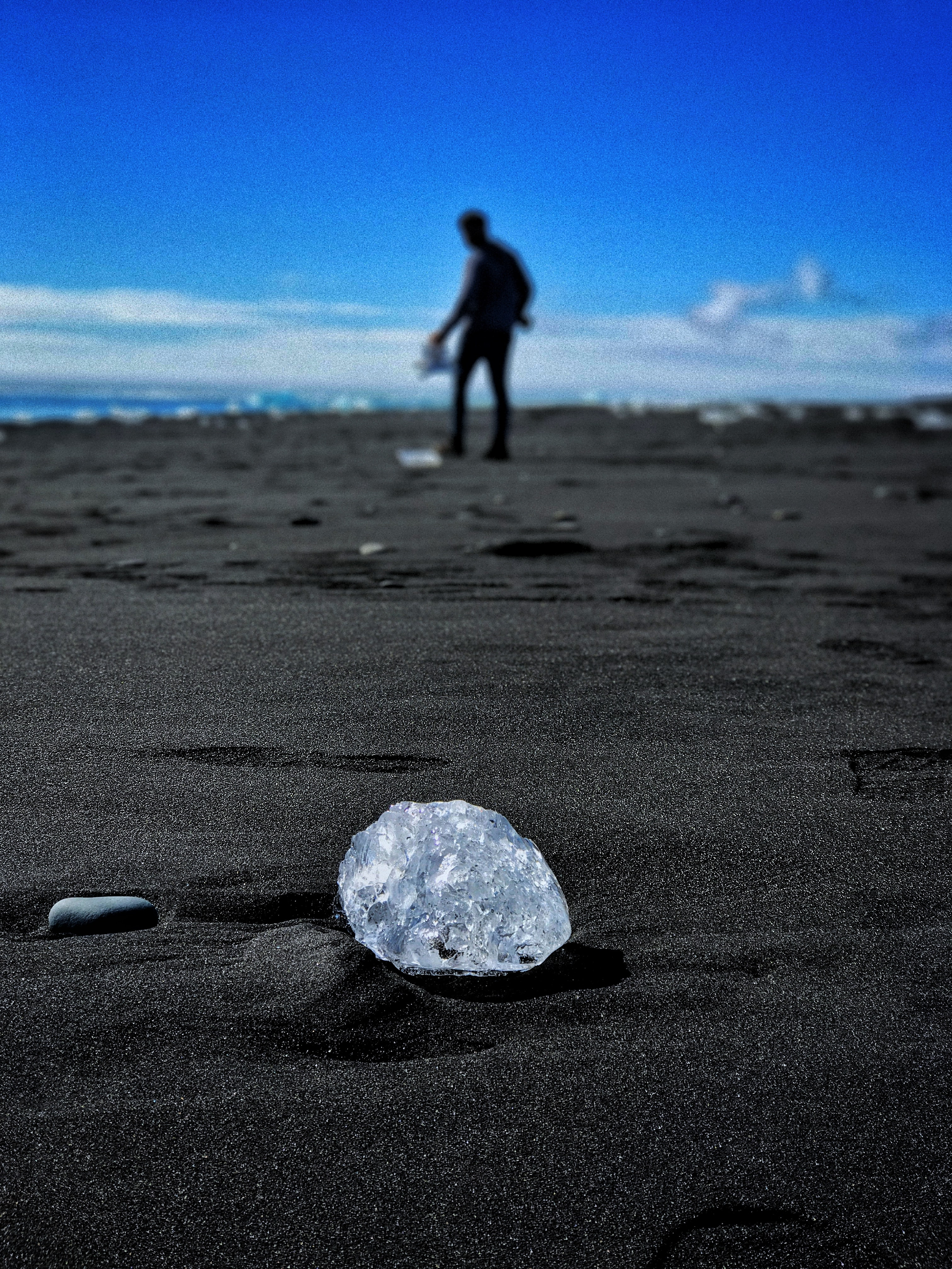 round clear gem stone on ground