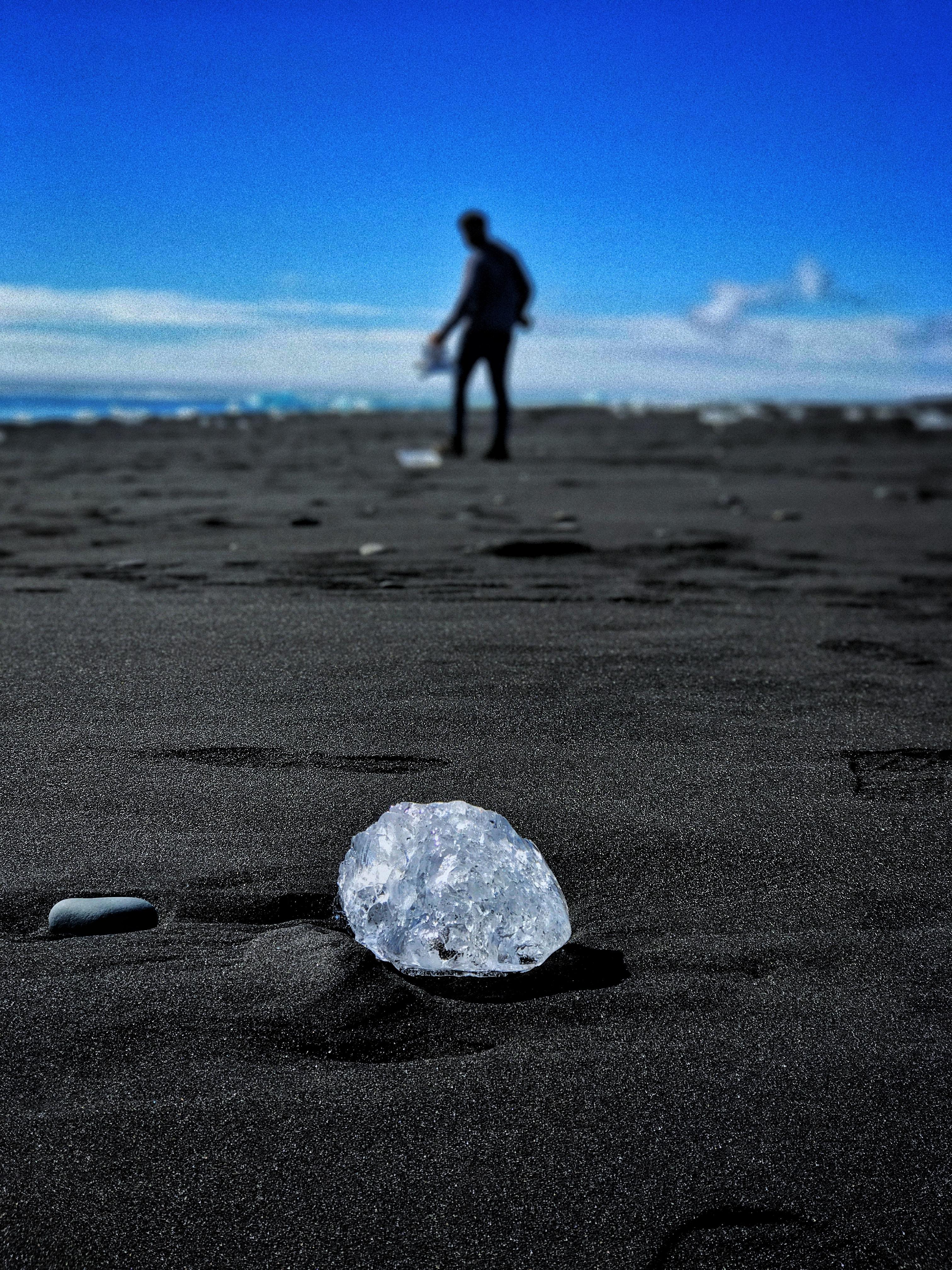 round clear gem stone on ground