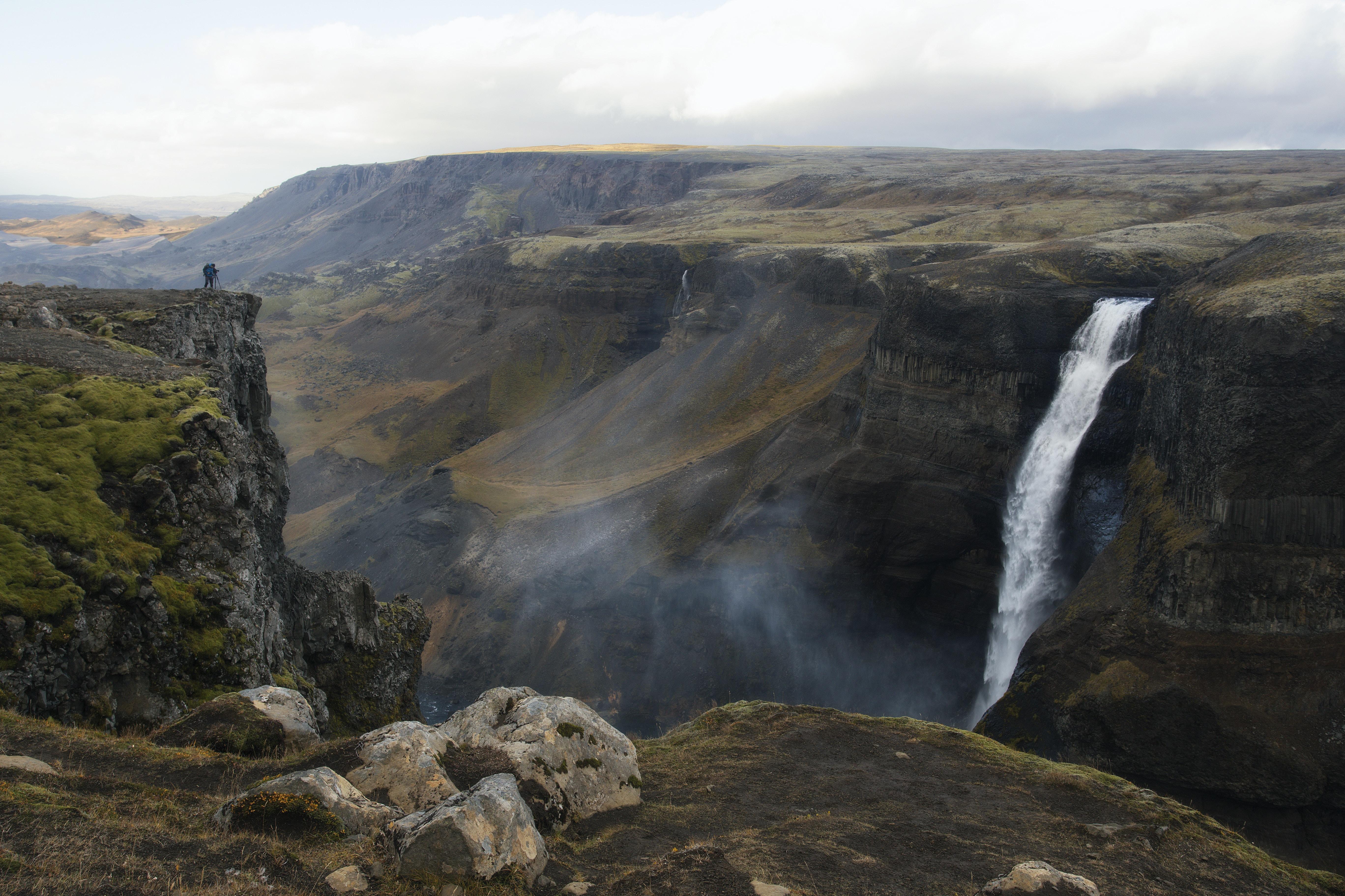 waterfalls on mountain under gray sky