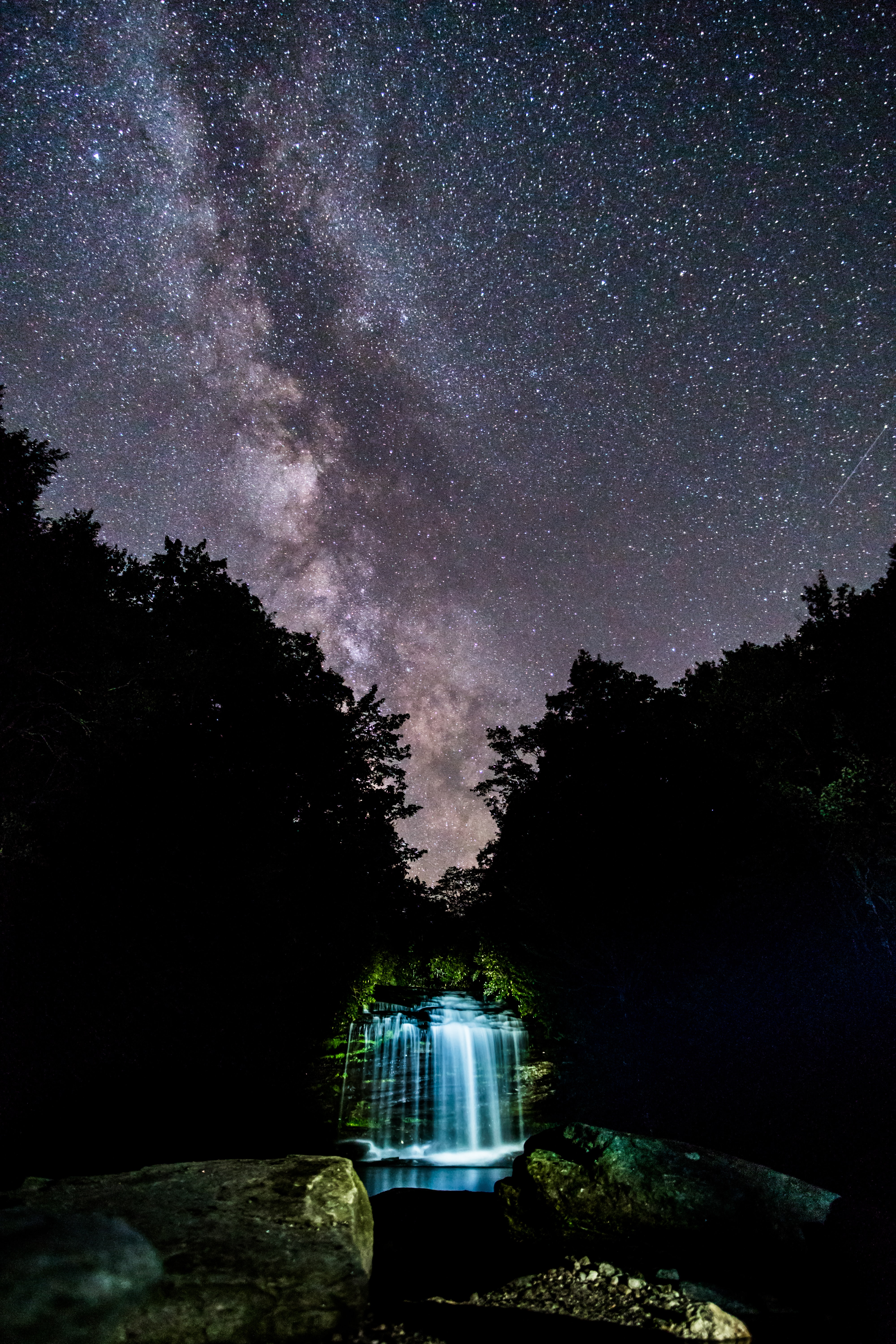 waterfalls under starry night