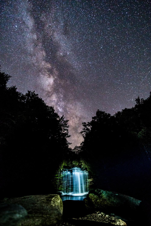 waterfalls under starry night