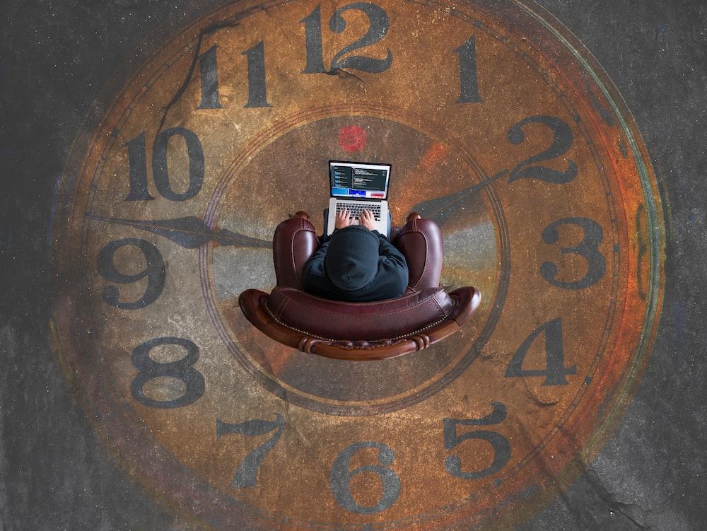 brown analog clock