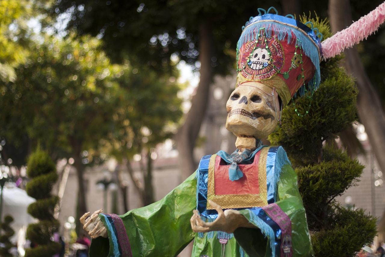 Día de Muertos skeleton statue near tree