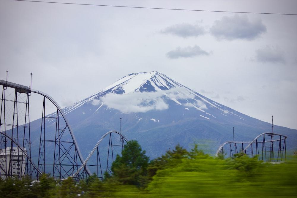 blue mountain under gray sky