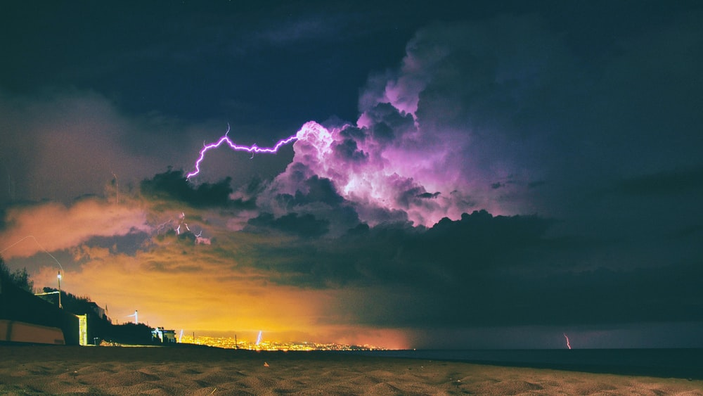 seashore under nimbus clouds