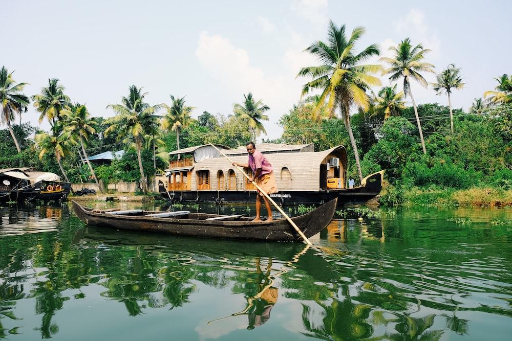 man riding on boat during daytime