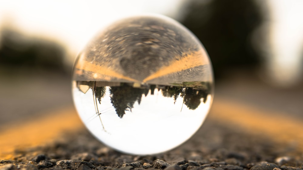 clear glass ball on ground during daytime