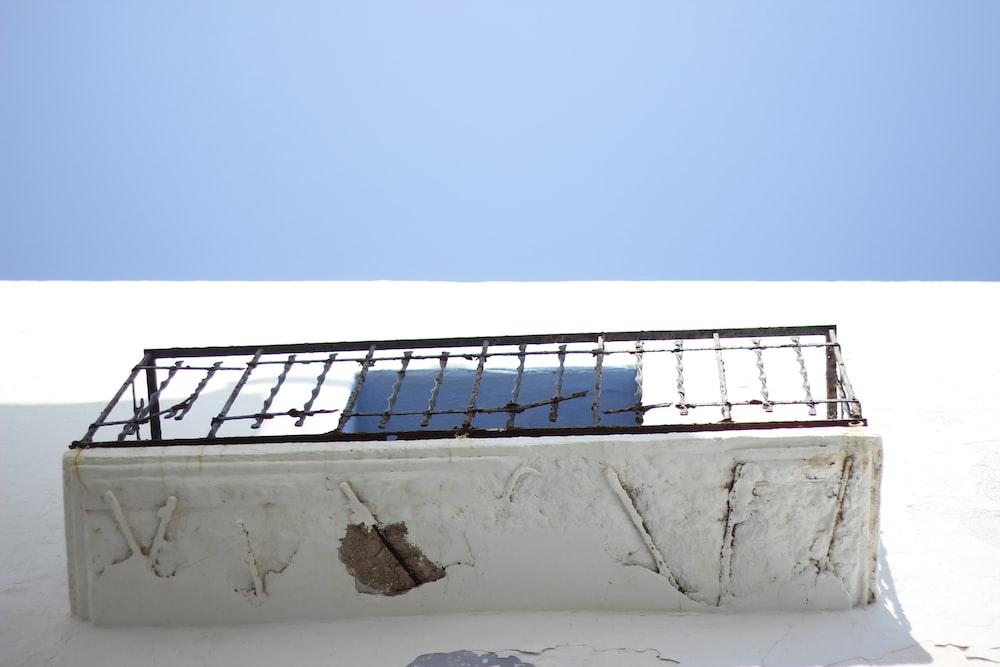 low angle photography of black metal balcony rails