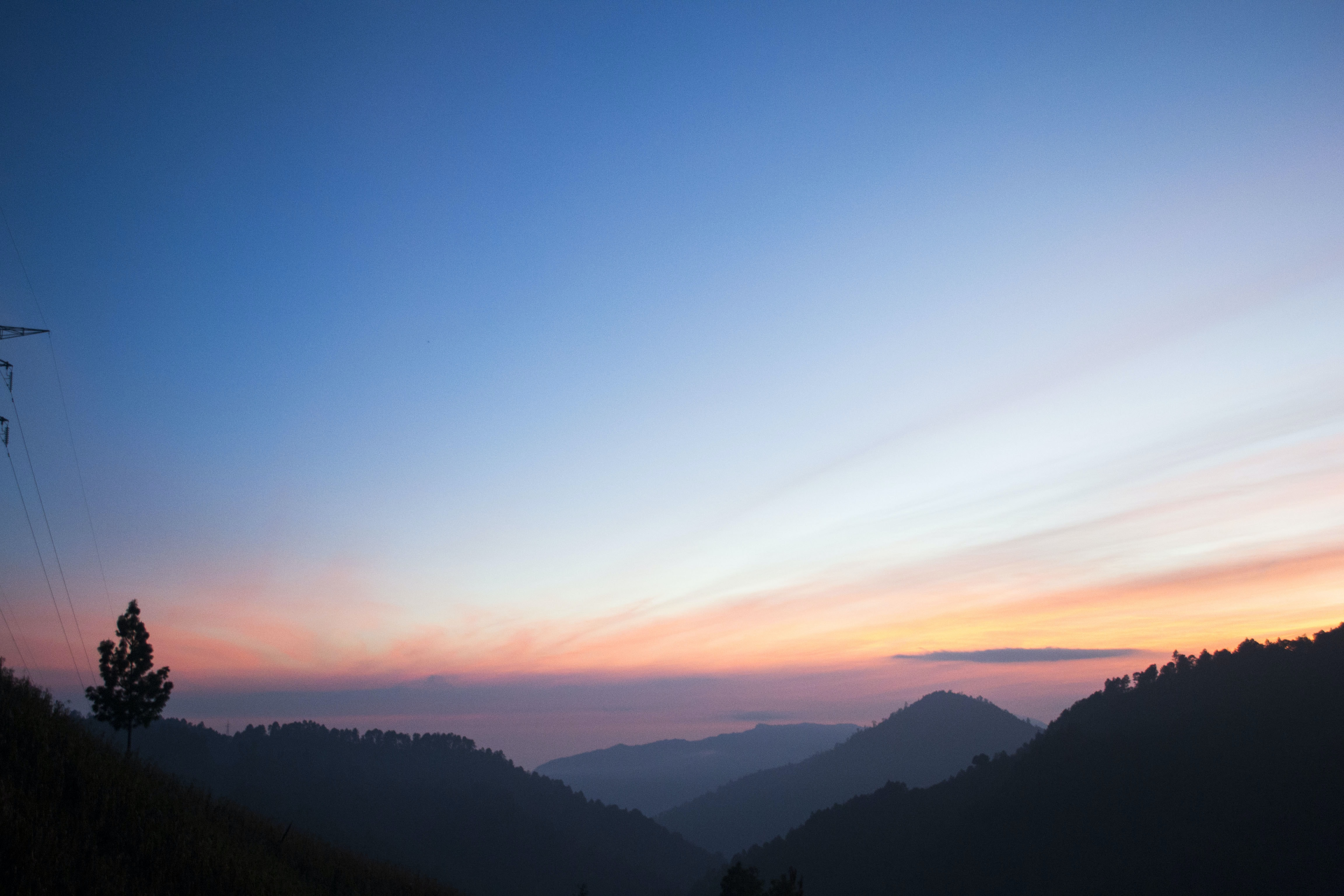 silhouette of mountains under blue sky