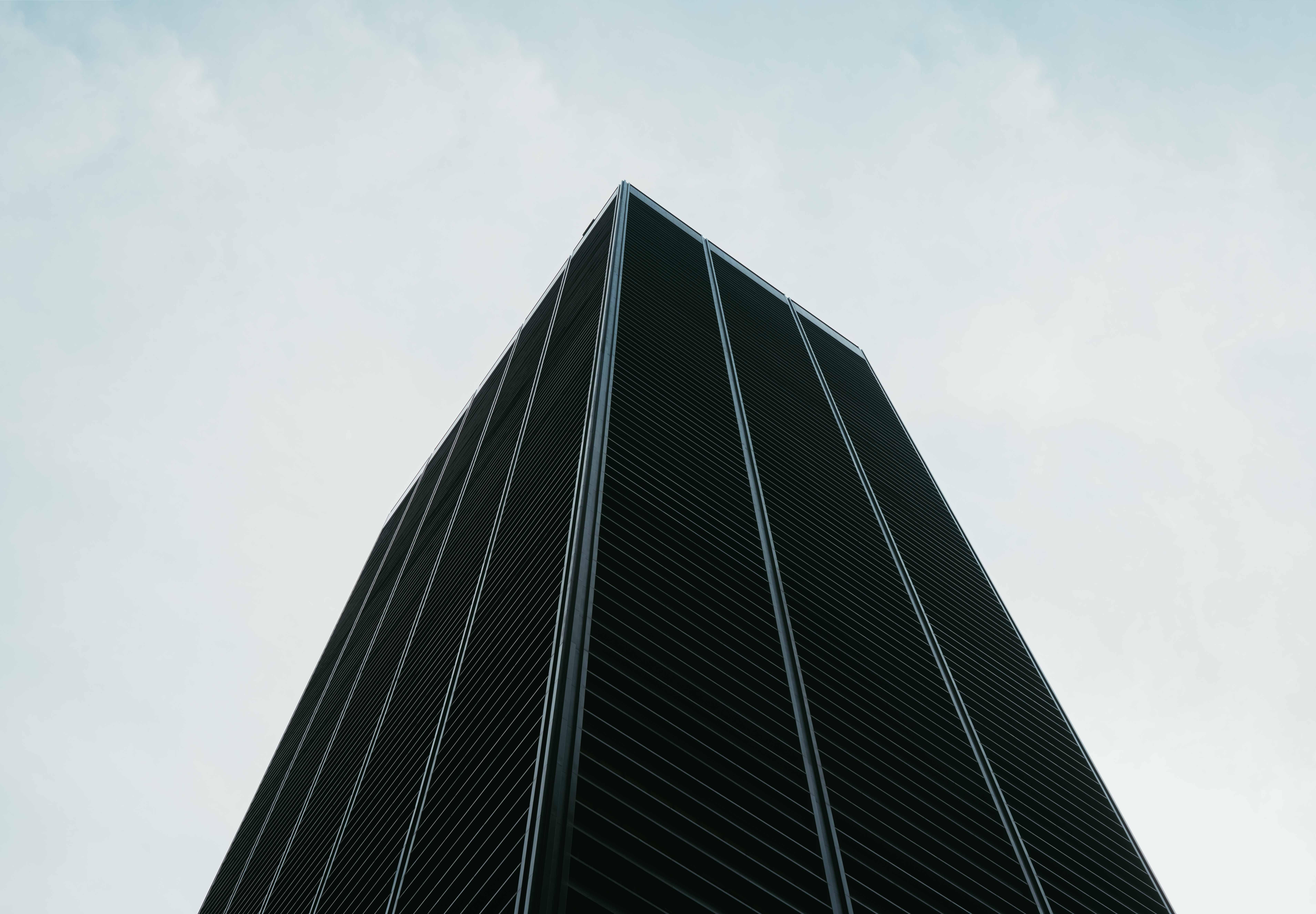 worm's eye view of black buildings