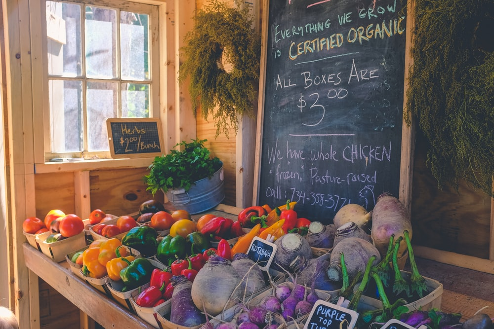 variety of vegetables display with Certified Organic signage