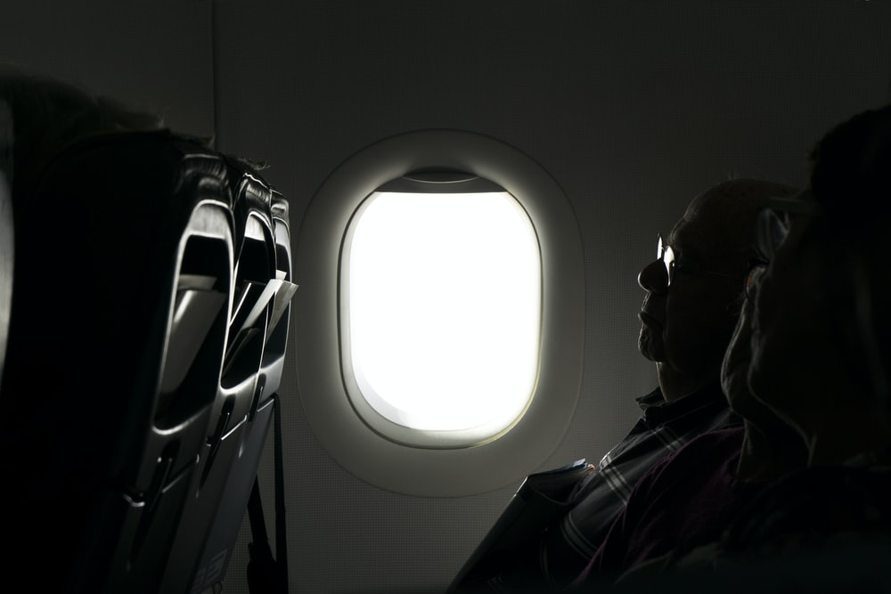 two person sitting inside of airplane