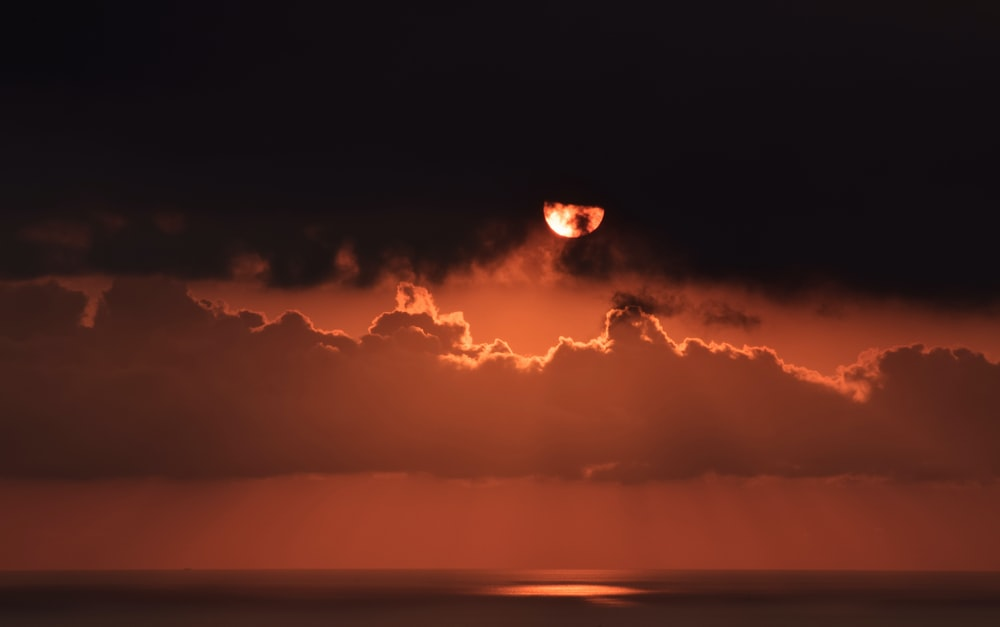 photography of red moon