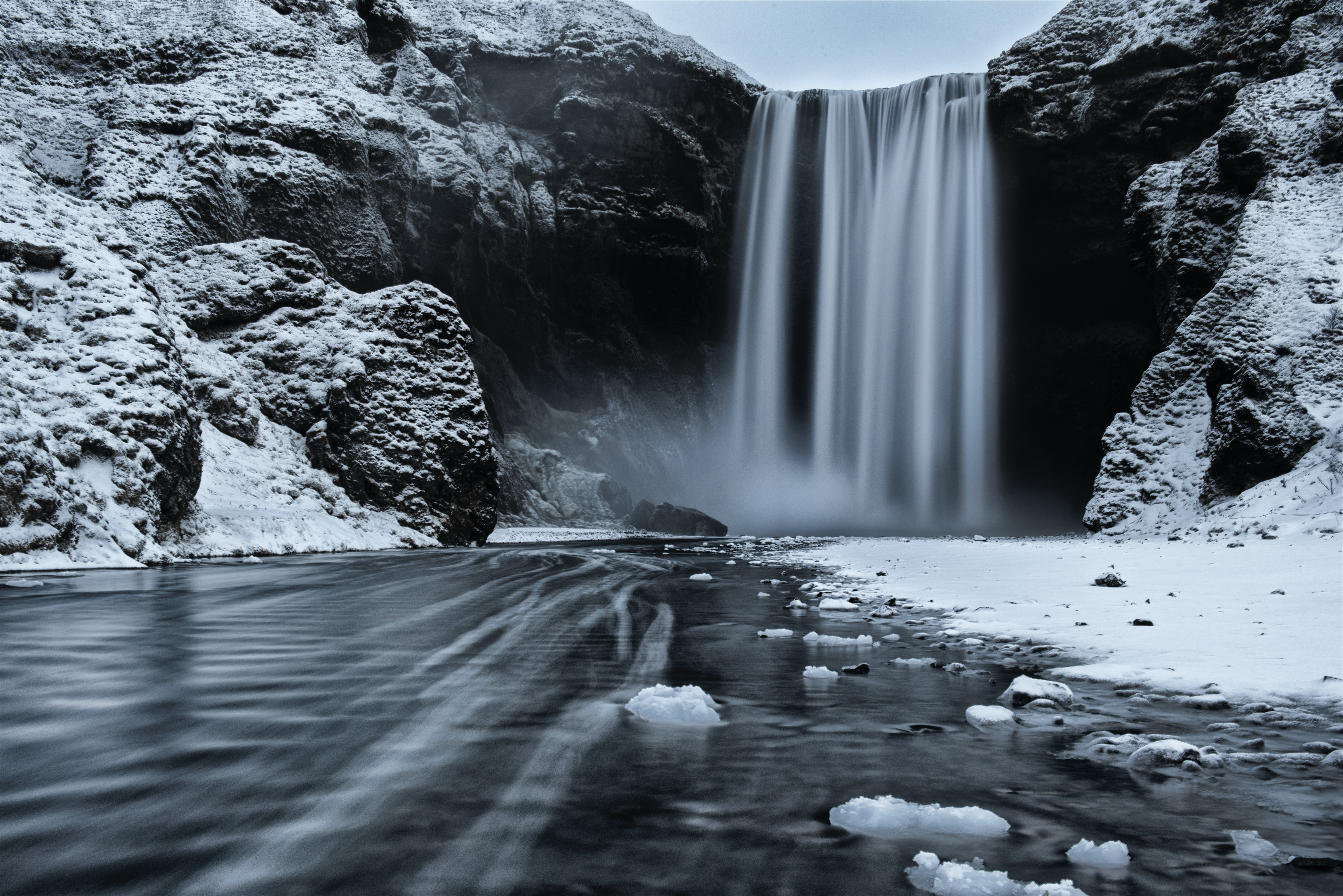 grayscale photo of waterfalls