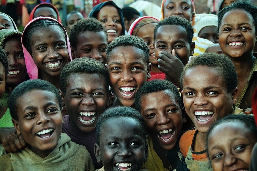 smiling children gathering taken during daytime