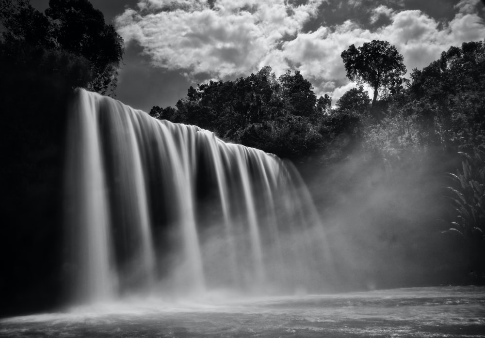 grayscale photography of waterfalls