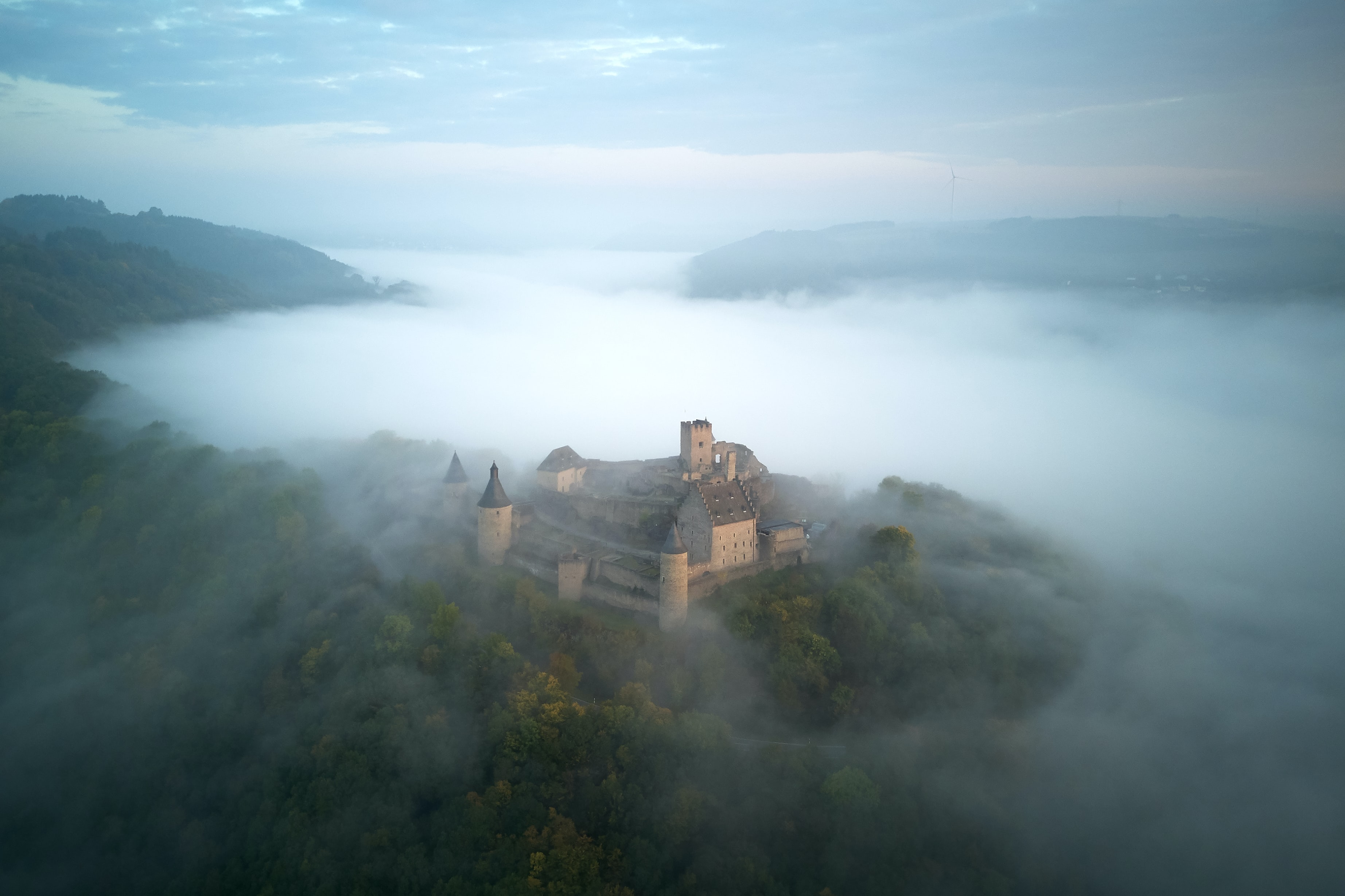 brown house surrounded with fog