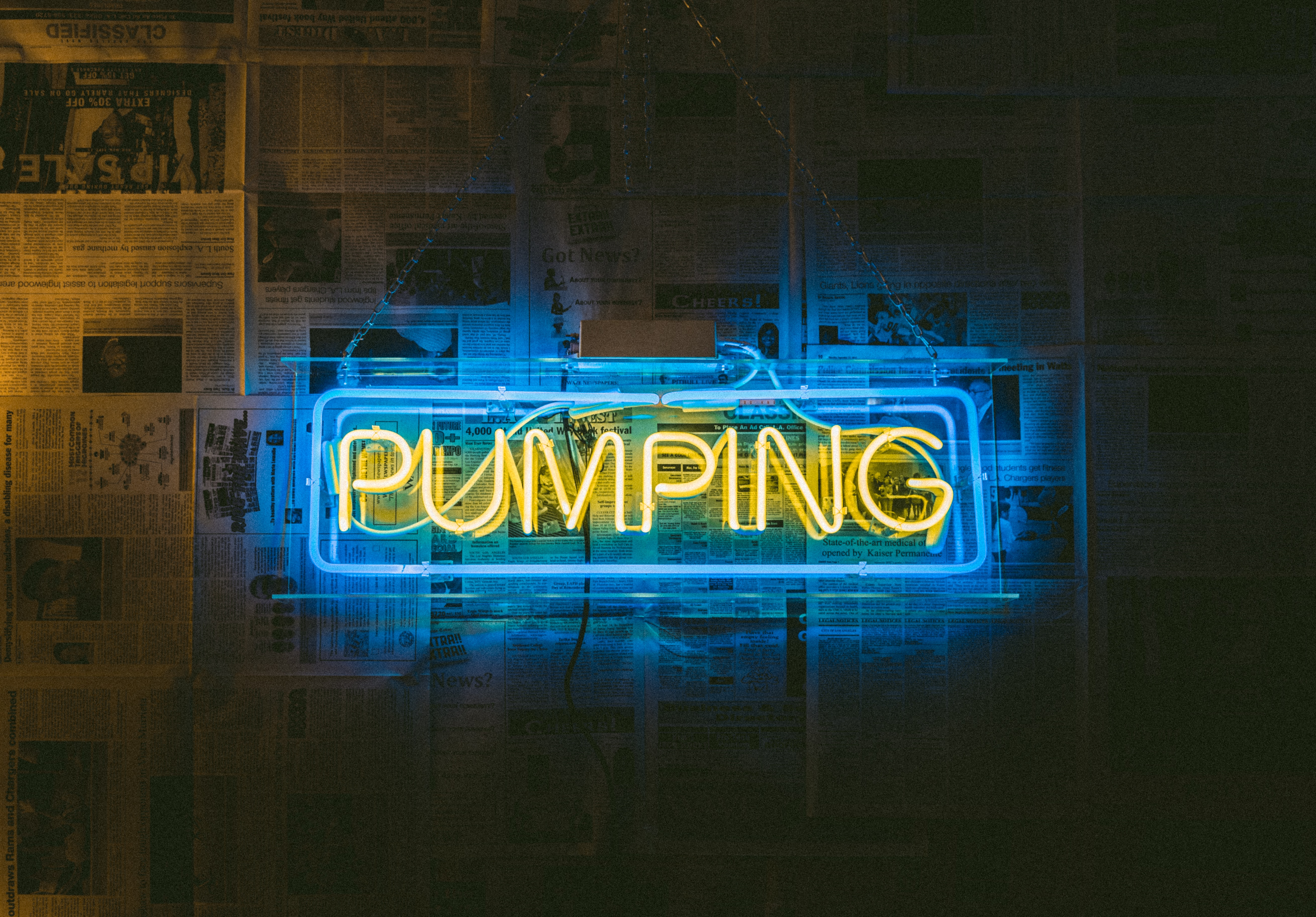 yellow and black Pumping neon signage