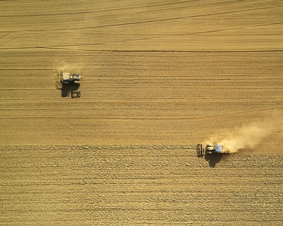 I had this shot in mind already long before I took it. And as it often happens, I wasn't planning on being able to take it on that day, but then I saw both tractors on their field from 1km away, and so I started up the drone. Although I had to work against strong winds, I was able to capture what I had imagined before.