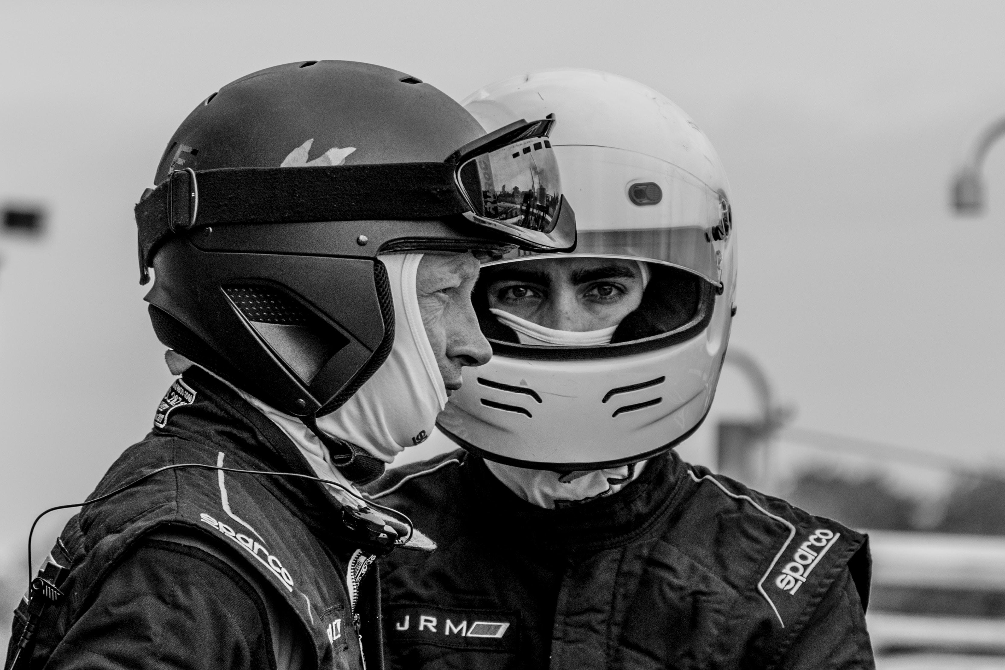 two man wearing helmets