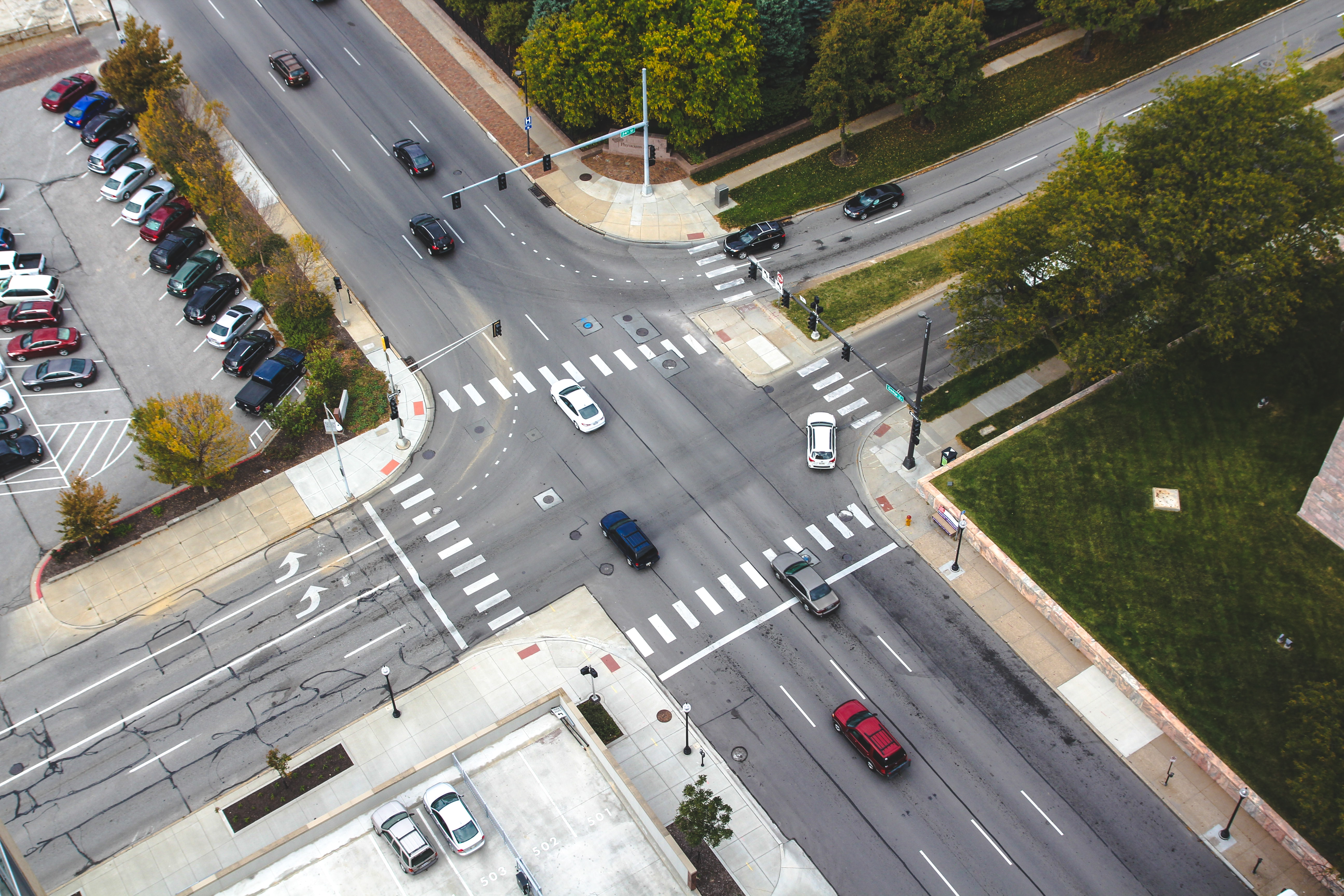 aerial photography of cars on road intersection