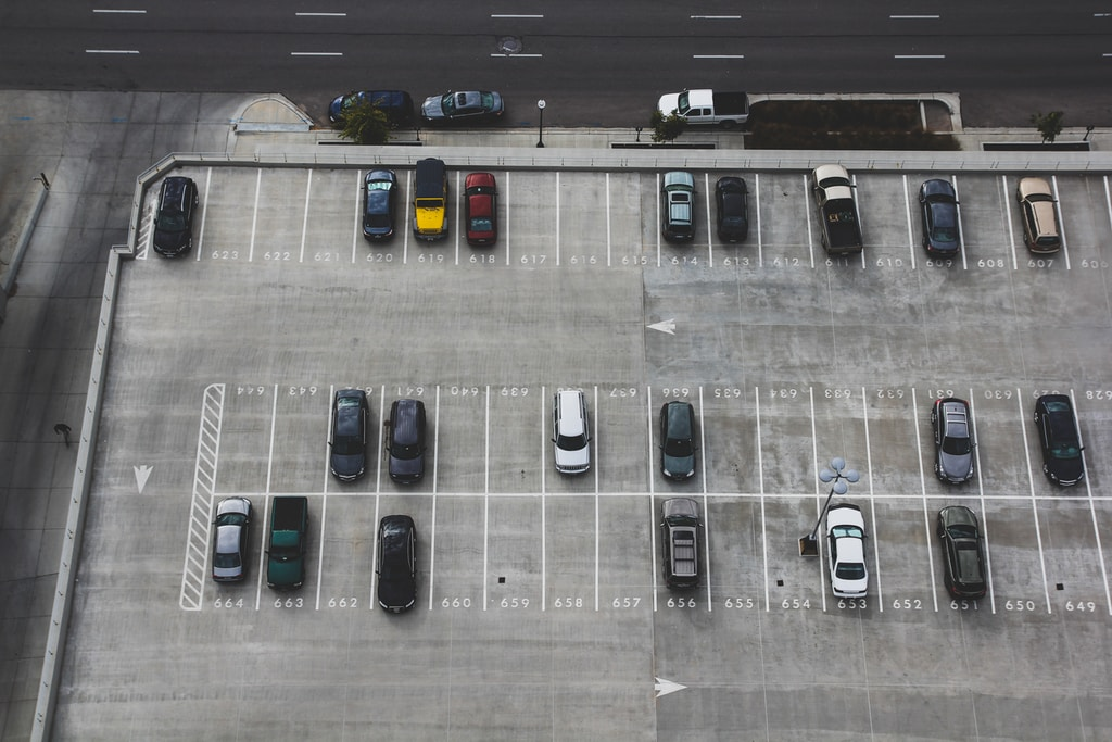 aerial view of cars parked on parking lot