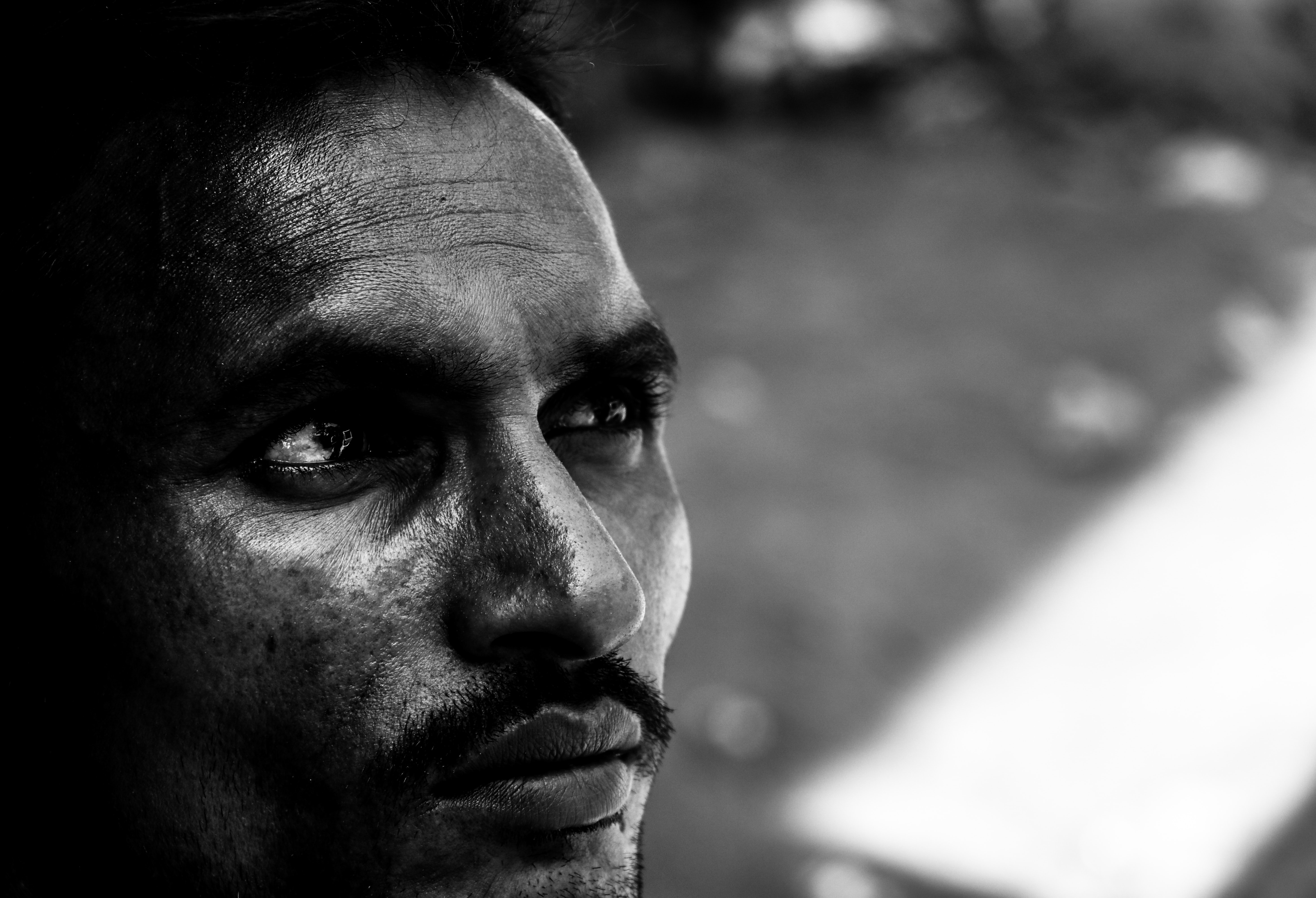 grayscale photography of man's portrait