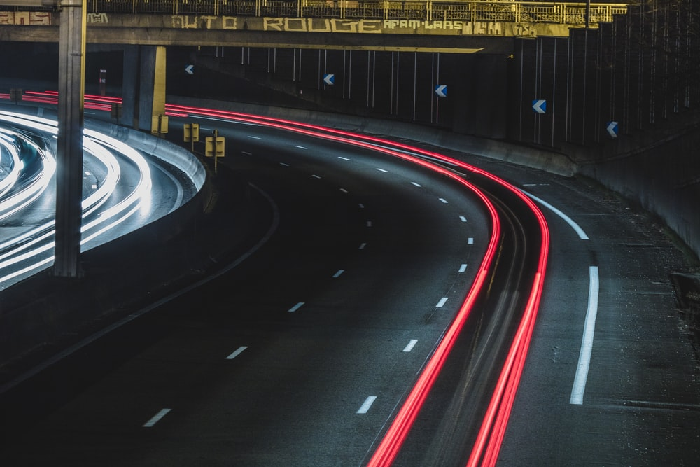 long exposure shot of cars on a road at night