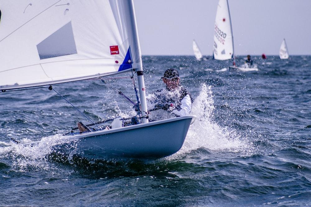 man riding sailboat
