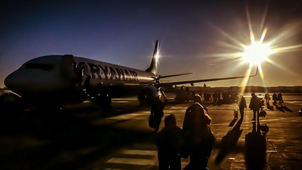 silhouette of people near plane