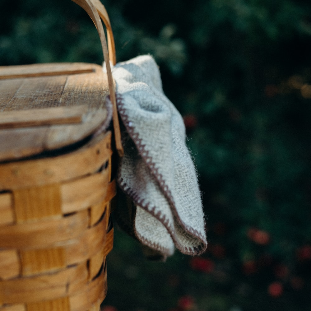 brown woven basket with white textile