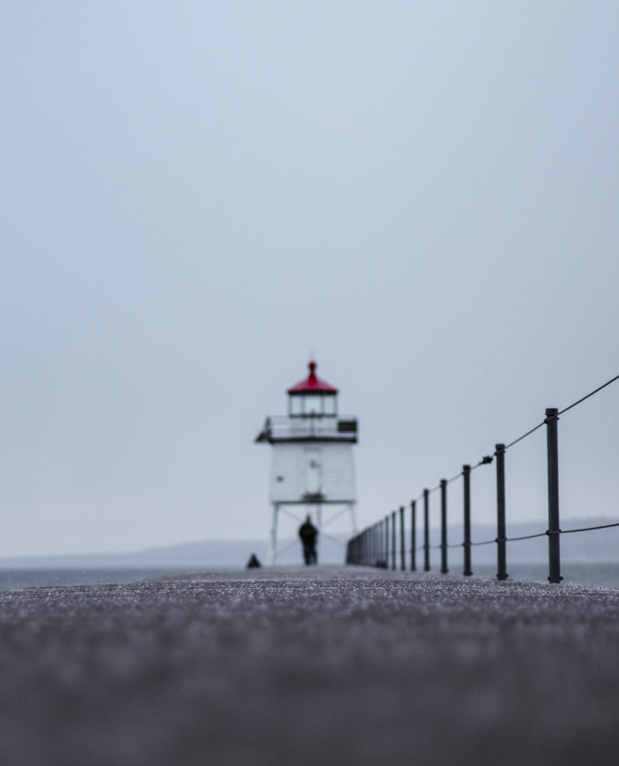 white lighthouse under gray sky during daytime