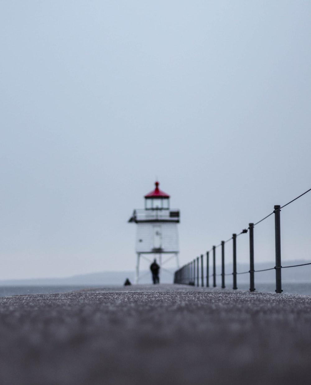 white lighthouse under gray sky during daytime