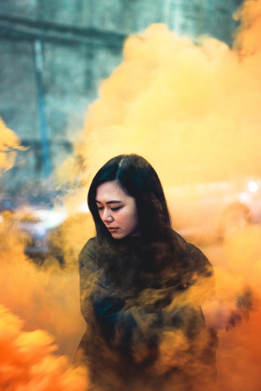 woman surrounded by orange smoke
