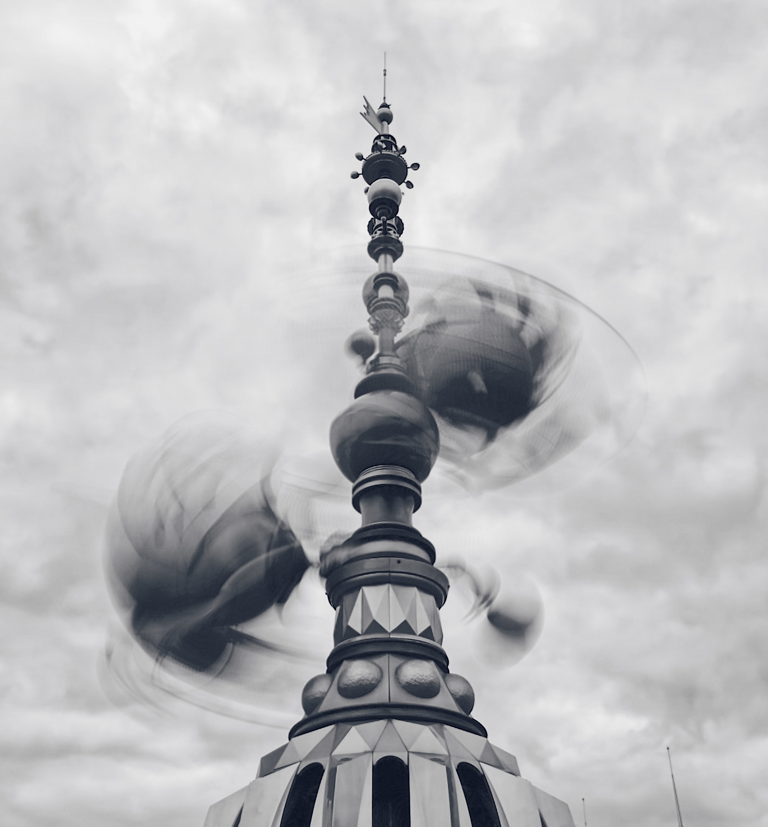 grayscale photo of spinning tower