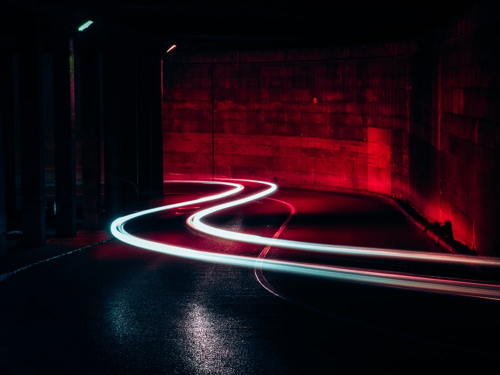 time lapse photography of light on road