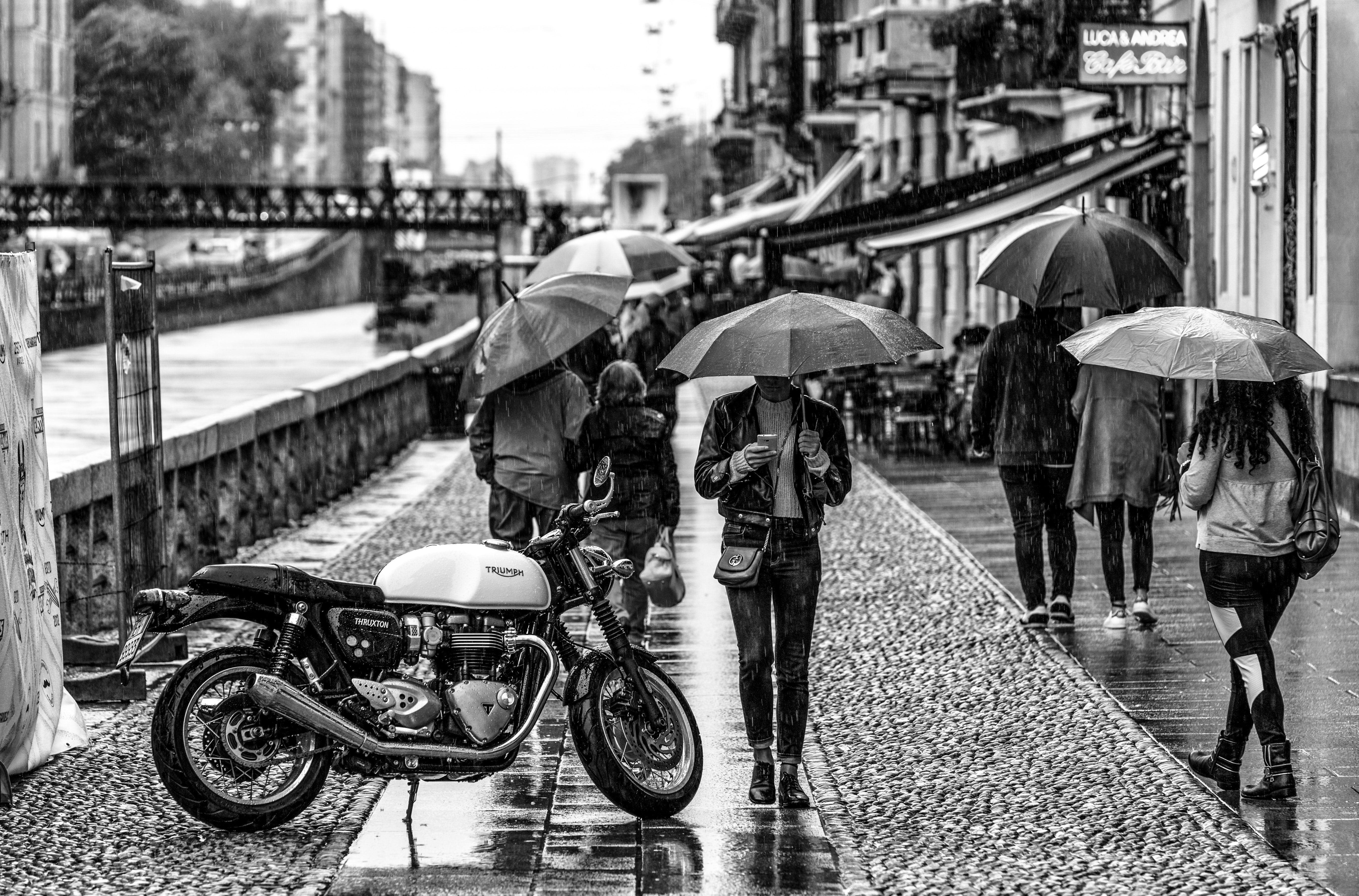 person under umbrella beside motorcycke